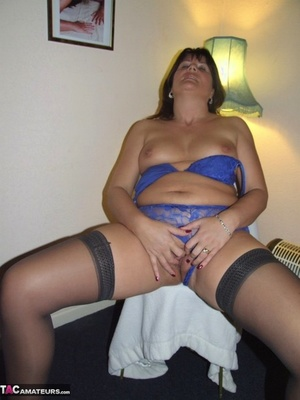 Wild Plumper mom Sandy strips nude to stretched pussy lips in lace undergarments