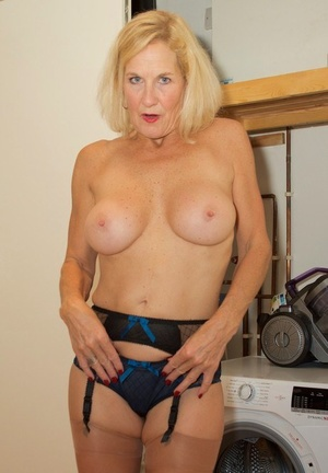 Mature light-haired Molly Mummy strips bare after doing housework in 3 piece undergarments
