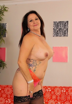 Thick amateur MILF Leylani Wood teasing in black stockings and high high-heeled slippers