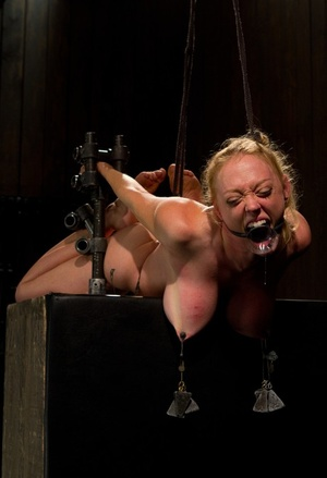 Dee Williams experiences hardcore bdsm with metal restrain bondage and humiliation