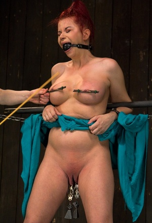Helpless redhead Sarah Blake is hooded and tortured before being drained