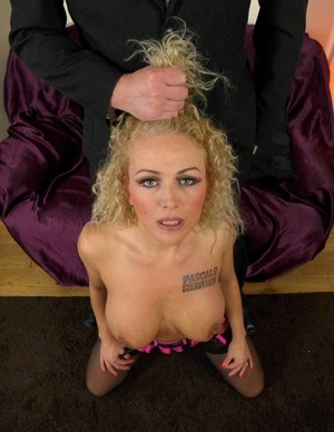 Older blonde lady Rebecca Smyth exposes her tits and twat before being branded