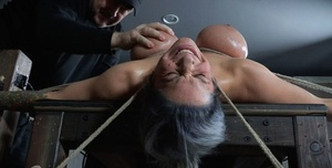 Restrained female Alyssa Lynn endures mounds torment and and being draped
