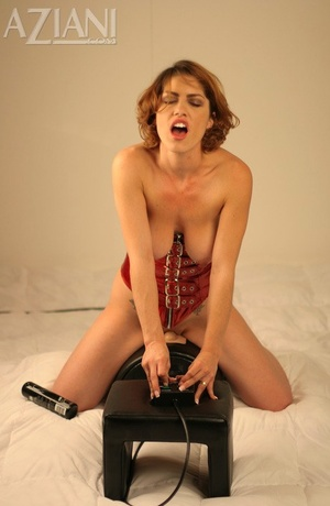 Hot redhead Kimtakes the sybian saddle machine for a test run and feels the love