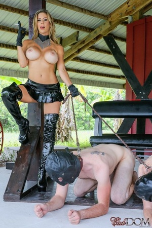 Busty blonde Alexis Fawx makes a couple of masculine slaves kneel