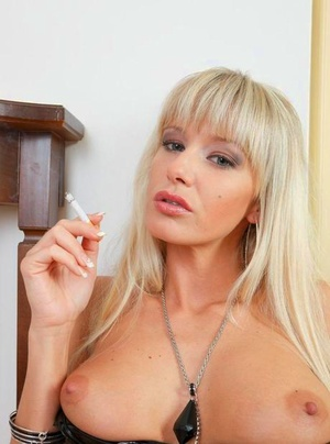 Platinum blond girl Natalli rips open her latex dress and pulls down her g-string