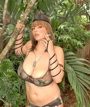 Solo model Christy Marks puts down a smoke to flaunt her hooters in the bushes