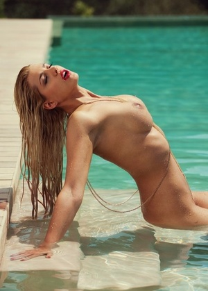 Hot ash-blonde Sarah Nowak models naked for Playboy in and out of swimming pool