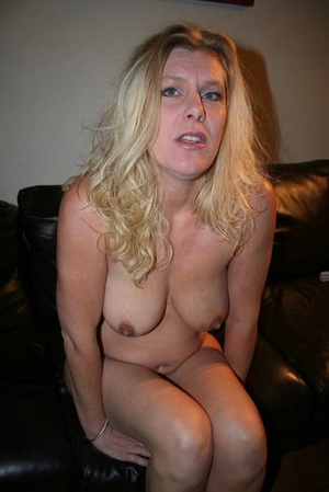 Blonde amateur endures having needles inserted into an exposed breast
