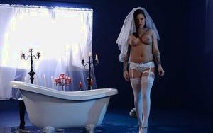Tattooed babe Karmen Karma spreading wet pussy in candle lit bathtub