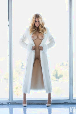 Blonde Germanic female Kennedy Summers unwraps her sensual lingerie