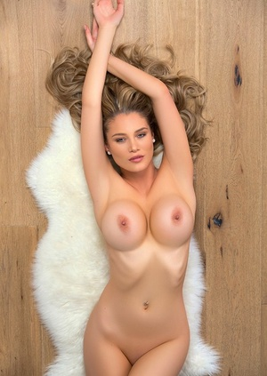 Hot blonde chick Anna Opsal tales off her wonderful undergarments for a centerfold shoot