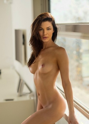 Hot brunette Jenny Watwood unzips to model naked for centerfold shoot