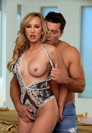 Busty blonde Brett Rossi is relieved of undergarments before pussy to mouth action