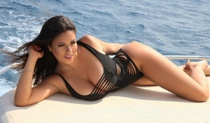 Hot centerfold model Fabiana Britto hits great non nude poses in a swimsuit
