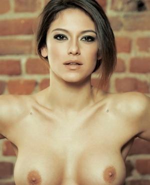 Tattooed chick Elena Petkova strikes hot solo poses for Playboy