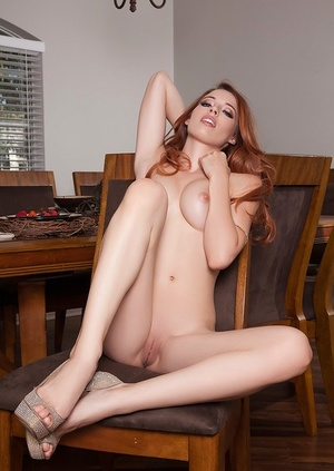 Busty redhead model Caitlin McSwain showing off phat ass and excellent legs