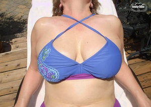 Sexy mature lady Busty Bliss sets her natural tits free of bikini top
