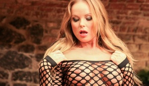 Blonde female Silvia Saint hikes her revealing dress to reveal her bald snatch