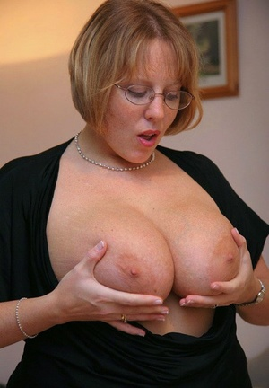 Fat amateur Curvy Claire pulls her huge tits out from under her clothing
