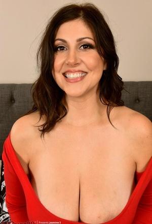 30 plus chick Jasmine S shows her landing strip twat after baring her big boobies