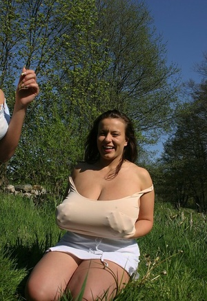 Lesbians Ines Cudna & Aneta Buena play with each others breasts in stream