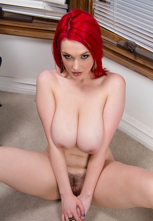 Frisky redhead sweetie exposing her amazingly big melons and hairless slit