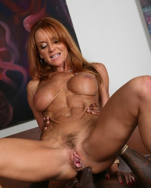 Redhead cougar Janet Mason heads 1 on 1 with the Big black cock of Flash Brown