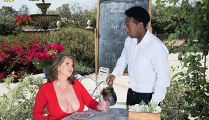 Older woman Kerry Martin seduces the black waiter with her huge breasts