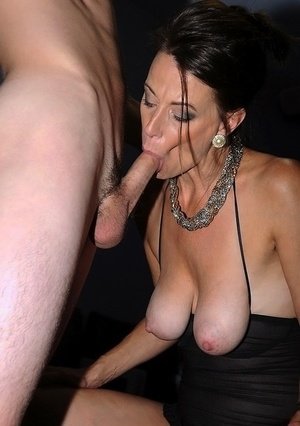 Brunette cougar Mimi Moore sucks her boy toy's dick in sheer black lingerie
