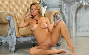 White solo dame Tanja X stands naked while modeling for a glamour shoot