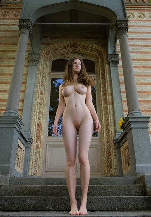 Busty shapely Susann goes naked on the steps outside to display nice big baps