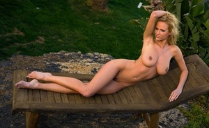Slender solo girl Sabina touts her big orbs while modeling naked on lounge chair