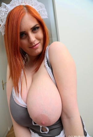 Redhead maid Alexsis Faye licks a nipple after freeing ample mounds from uniform