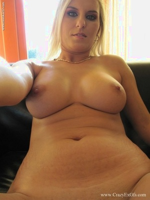 Blonde amateur takes self shots as she exposes her fat boobs