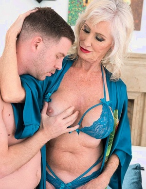 Sexy nan Leah L'Amour pleasures a young dude with a BJ and titty fuck