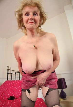 Old British woman Pearl uncups her large boobs before showcasing her snatch