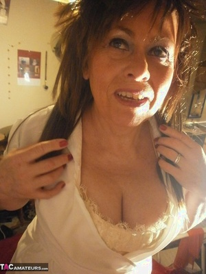 Mature chick Caro gest decked out in naughty nurse attire for a live cam show