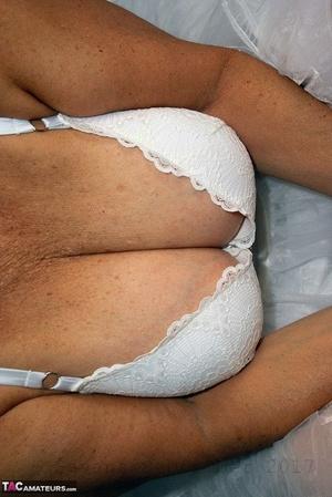 Brazen plump granny Savana flashes panty upskirt in tutu & sparkly high heels