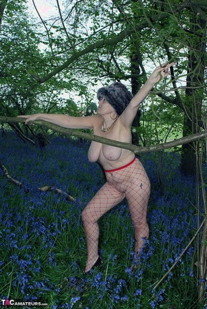 Mature damsel removes her winter glaze to display her big naturals in mesh pantyhose