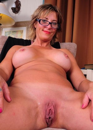 Mature chick Skyler C does a striptease until her meat curtains are on display