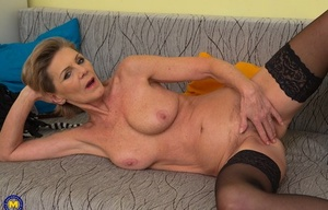 Great looking granny with big juggs fucktoys herself on the couch