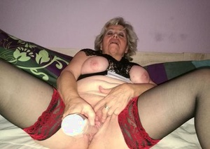 Crazy old lady Caro removes white panties to fake penis her pussy in sexy stockings