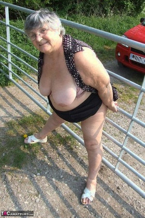 Horny granny Grandma Libby exposes ample big tits and ample ass at the farm