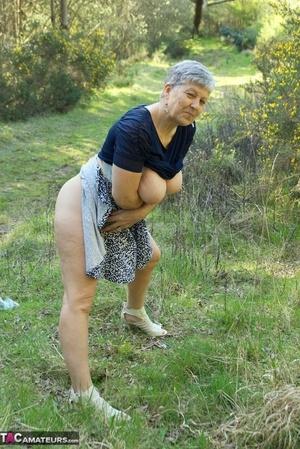 Naughty granny Savana reveals her big juggs and juicy ass in public