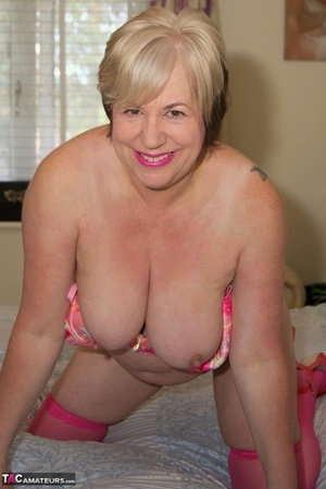 Overweight granny Speedybee dildos her pussy in pinkish stockings
