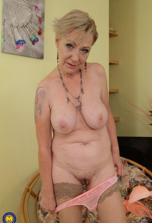 Naughty granny spreads her legs to masturbated her super hot old pussy & finger