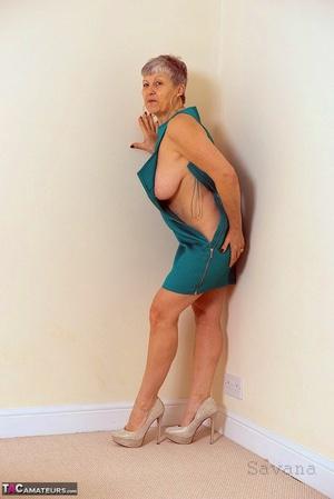 White granny Savana flashes no panty upskirts before exposing a big breast