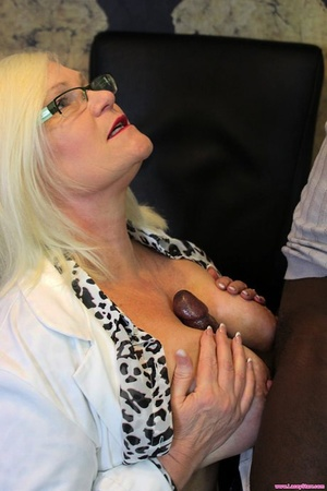 Horny granny Lacey Starr gets banged by a ebony fellow in her office