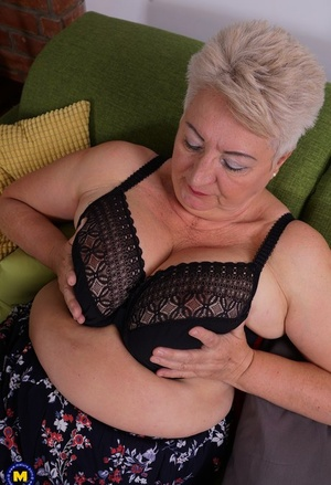 Fat grandmother strips down to black pantyhose before fingering her cootchie